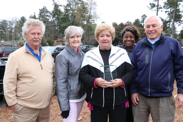 Pictured, from left, are Tri-Development Executive Director Ralph Courtney, Helping Hands Board of Directors President Vicki Snow, Miller, Helping Hands Inc. CEO Carmen Landy and Triple Crown Golf Committee Chairman Ron Jones.