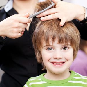Boy getting a hair cut